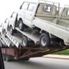 Грузовик везет 18 грузовичков